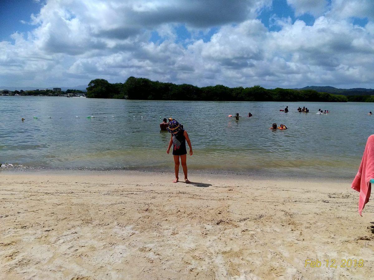 My son enjoying the beach, a family activity